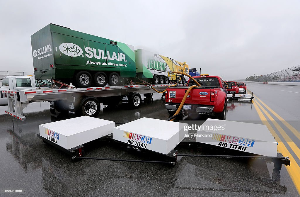 A view of vehicles on the track which are used with the NASCAR Air Titan drying machines which are prepared to be used to dry the track during qualifying for the NASCAR Sprint Cup Series Aaron's 499 at Talladega Superspeedway on May 4, 2013 in Talladega, Alabama.