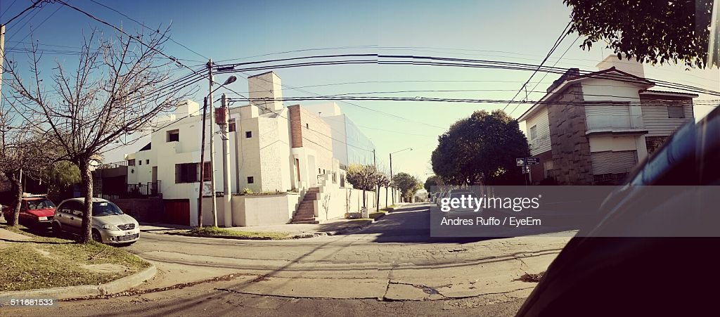 View of vehicles parked on road along buildings : Stock Photo
