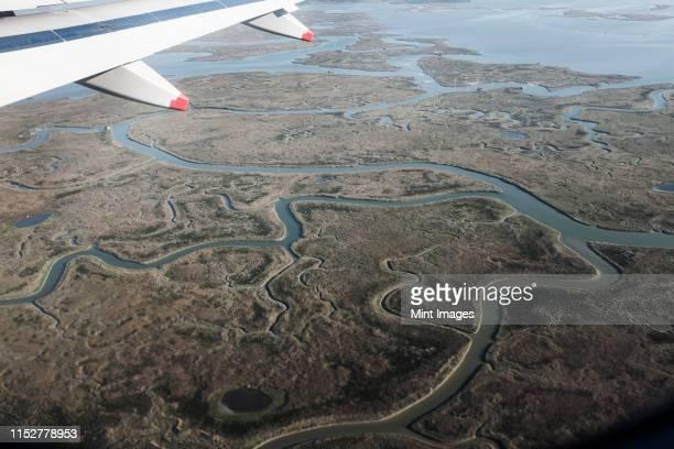 view of venice, veneto, italy from a passenger plane window. - laguna foto e immagini stock