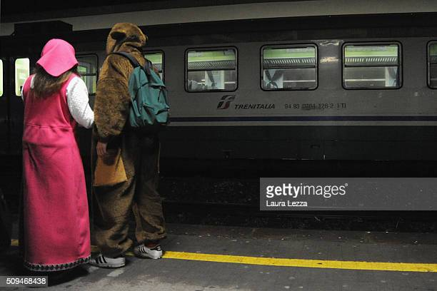 A view of Viareggio train station with people wearing carnival dresses during the traditional Carnival of Viareggio parade on February 7 2016 in...