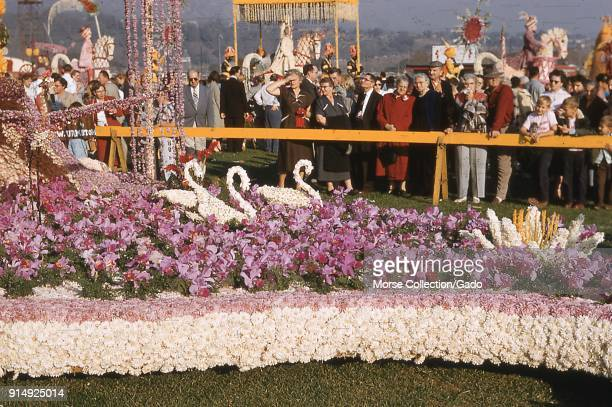 View of visitors admiring the orchid covered Occidental Life Insurance Company of California's Rose Royalty Revisited float at the public showcase in...