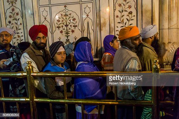 View of visitors as they stand in line for inner sanctum of in the Harmandir Sahib where the the Granth Sahib is kept Amritsar India February 23 2014...
