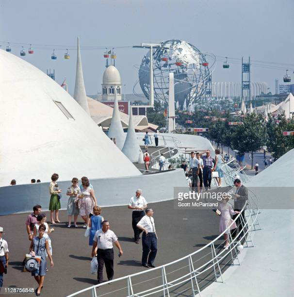 View of visitors as they walk along the elevated walkway at the Kodak Pavilion during the World's Fair in Flushing Meadows Park in Queens New York...