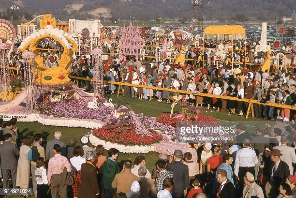 View of visitors crowded around the Occidental Life Insurance Company of California's grand prize winning float Rose Royalty Revisited at the public...