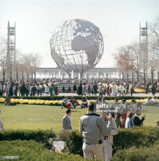 View of visitors gathered around the Flushing Meadows Unisphere during the World's Fair in Queens New York New York April 1965