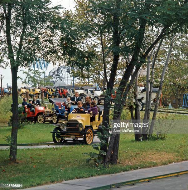 View of visitors including many children on the Avis Antique Car Ride at the World's Fair in Queens New York New York September 1965