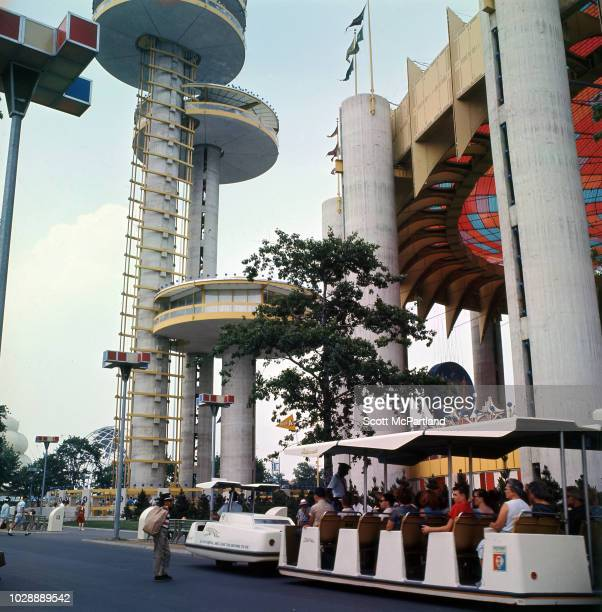 View of visitors on Greyhound's 'Glide O Ride' as it passes the New York State Pavilion at the World's Fair in Flushing Meadows Park in Queens New...