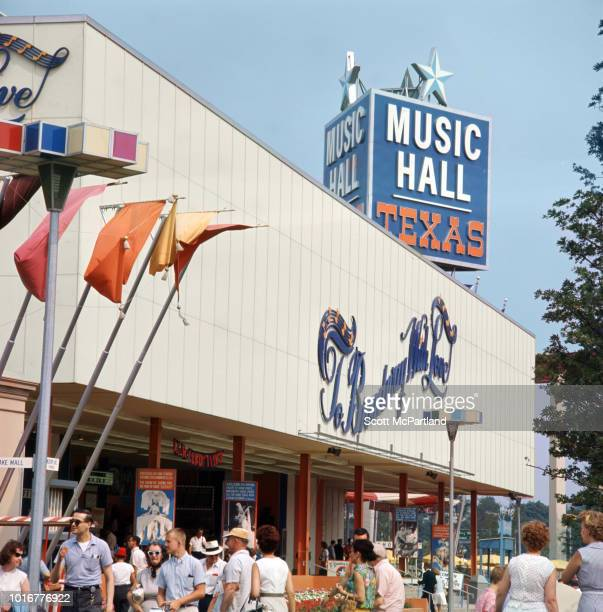 View of tourists outside the Texas Pavilion's Music Hall in Flushing Meadows Park during the World's Fair in Queens New York New York June 1965 The...