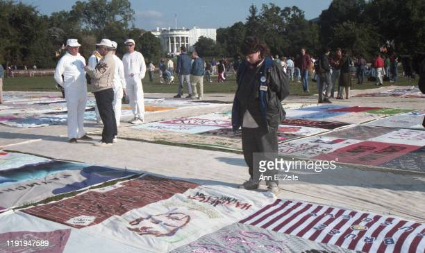 View of visitors to the NAMES Project AIDS Memorial Quilt as it is displayed on the National Mall Washington DC October 11 1996 They stand on...