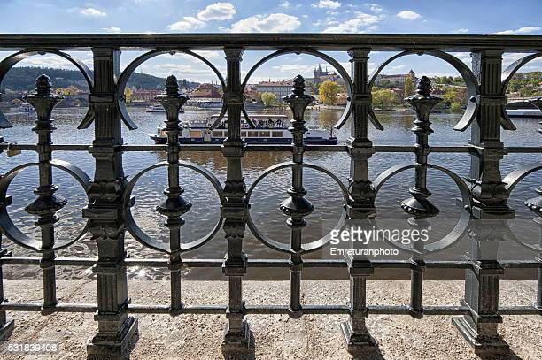 view of vitava river behind iron fences,prague - emreturanphoto stock pictures, royalty-free photos & images