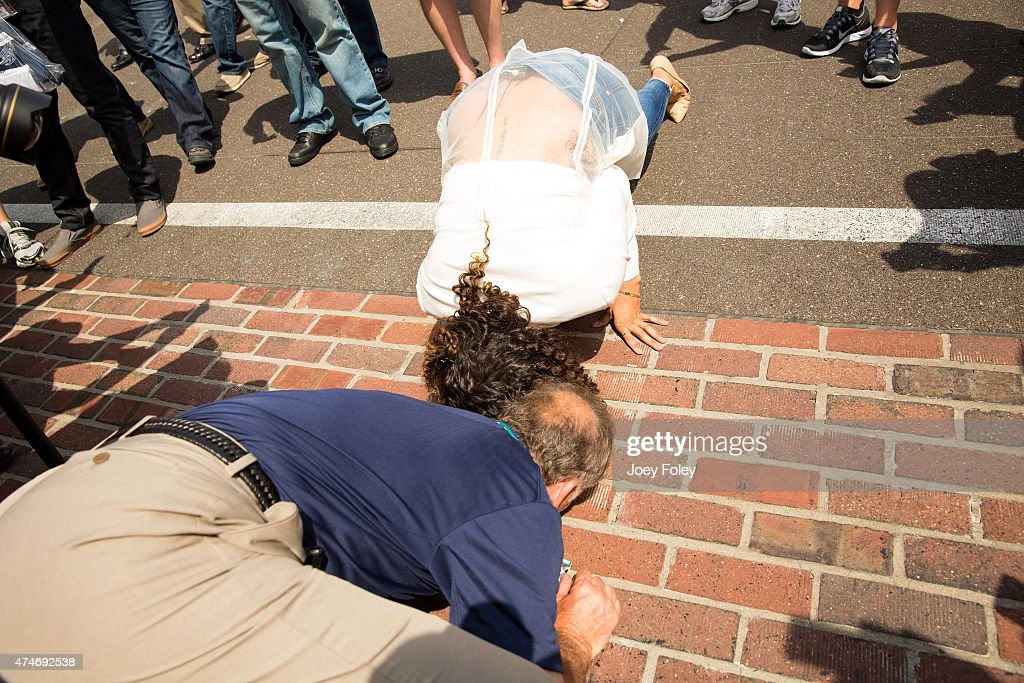 A view of vocalist Jordin Sparks kissing the yard of bricks during the 2015 Indy 500 at Indianapolis Motorspeedway on May 24, 2015 in Indianapolis, Indiana.