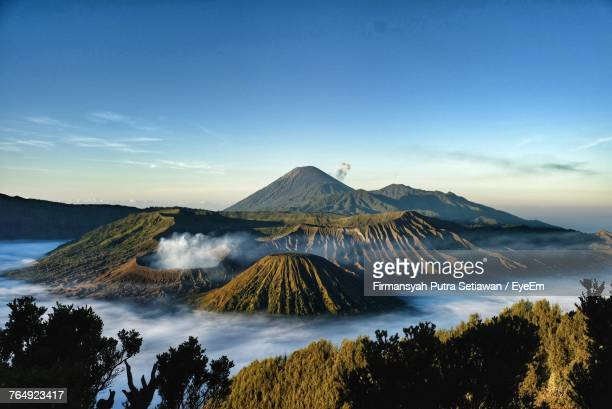 view of volcanic landscape against blue sky - surabaya stock pictures, royalty-free photos & images
