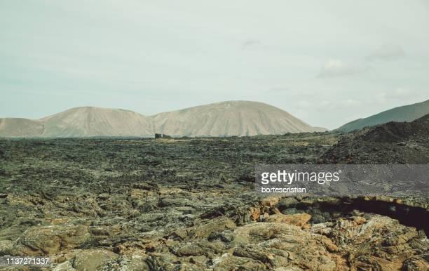 view of volcanic landscape against sky - bortes fotografías e imágenes de stock