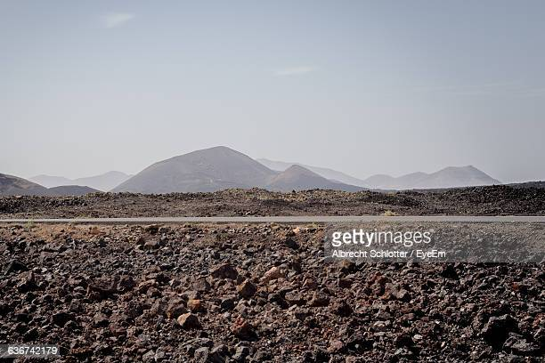 view of volcanic landscape against sky - albrecht schlotter stock photos and pictures