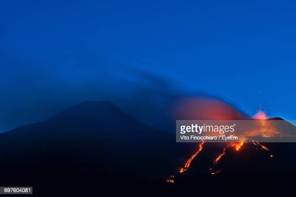 View Of Volcano Erupting At Night