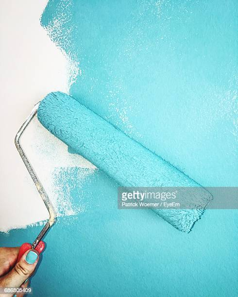 view of wall painting activity - paint roller stock pictures, royalty-free photos & images