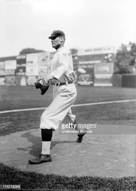 View of Walter Johnson, star pitcher for the Washington Senators, on the mound, Washington, D.C., 1913.