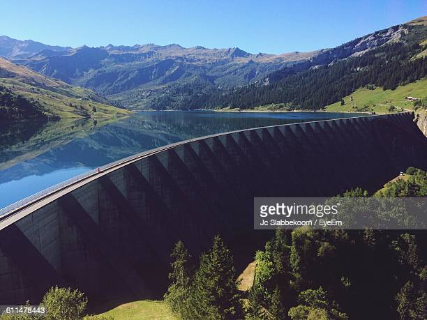 View Of Water Dam Against Mountains