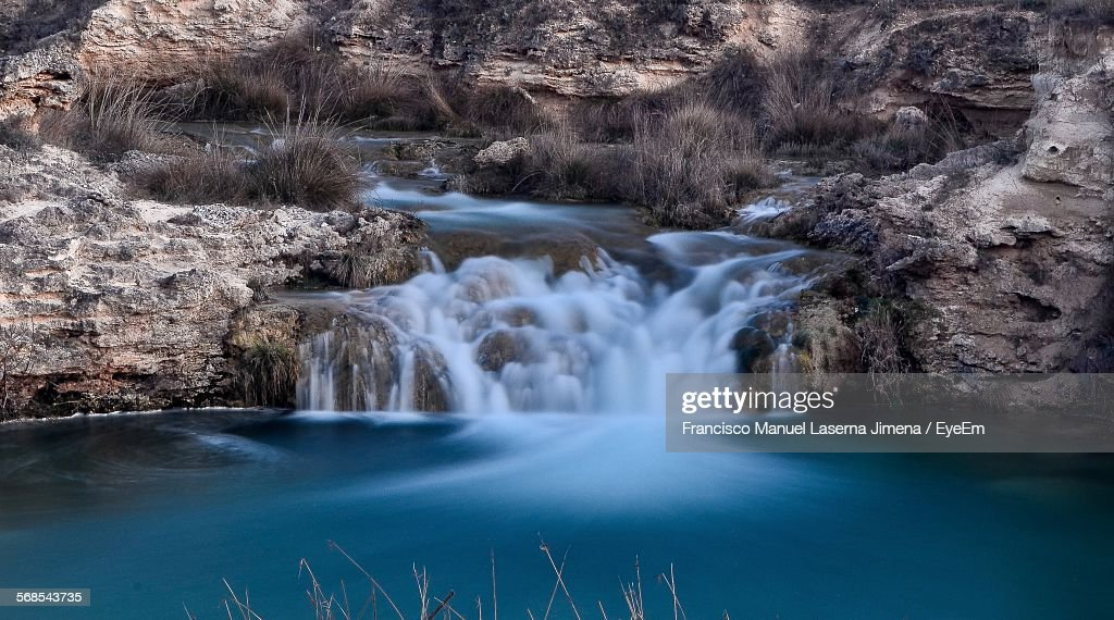 View Of Water Flowing Through Rocks In River : Stock Photo