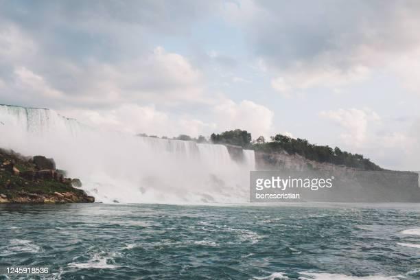 view of waterfall against sky - bortes foto e immagini stock