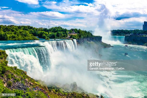 view of waterfall against sky - niagara falls stock pictures, royalty-free photos & images