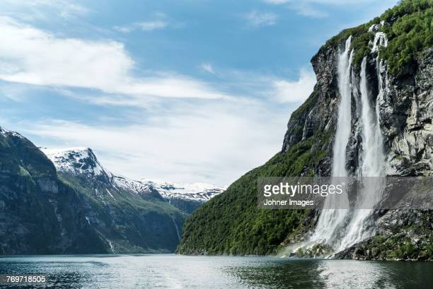 view of waterfall at lake - wasserfall stock-fotos und bilder