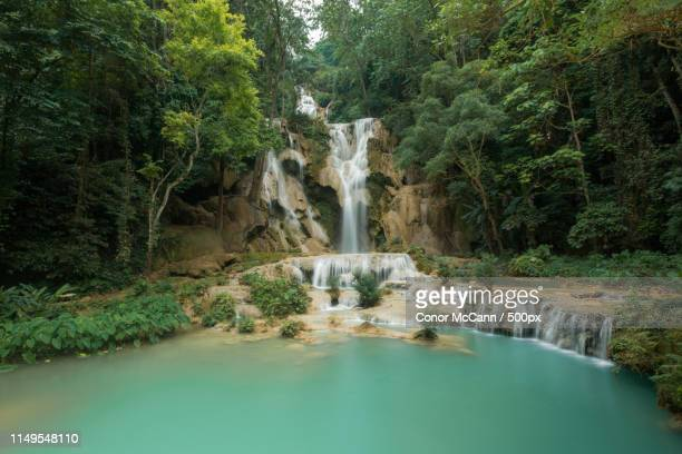 view of waterfall comes into lake - conor stock pictures, royalty-free photos & images