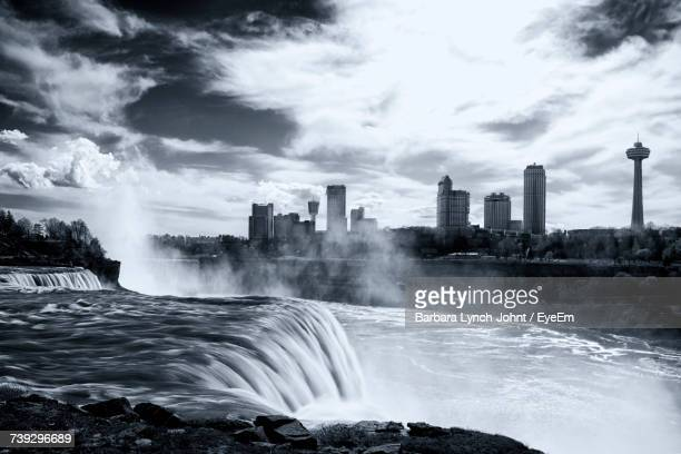 View Of Waterfall In City Against Sky