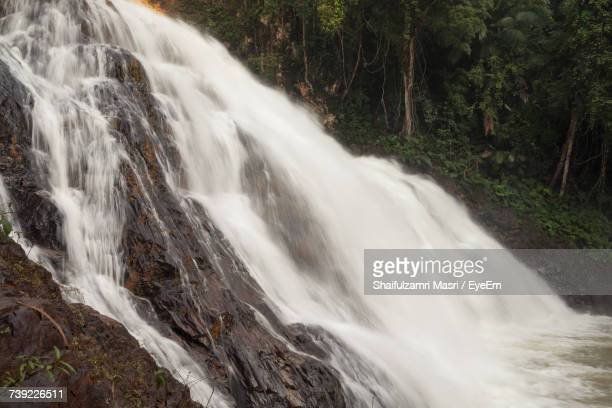 view of waterfall in forest - shaifulzamri stock pictures, royalty-free photos & images