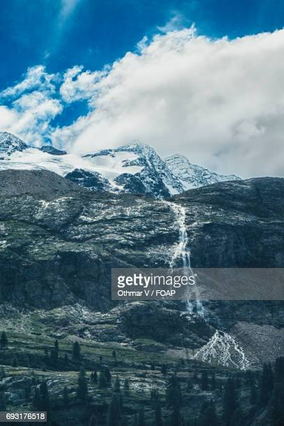 view of waterfall in martell valley, south tyrol, italy - martell valley italy stock photos and pictures