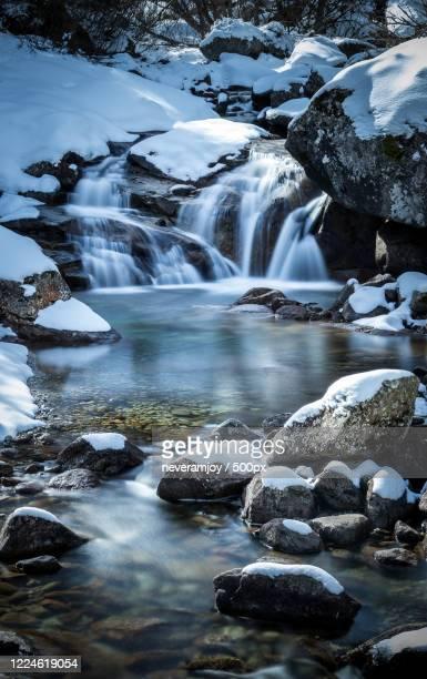 view of waterfall in winter, staffa, italy - ruscello foto e immagini stock