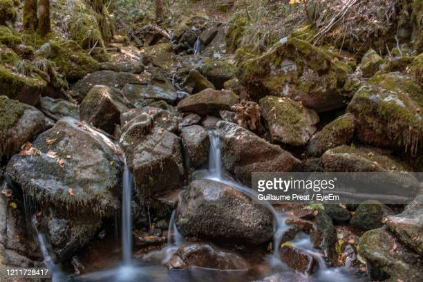 view of waterfall with rocks in foreground - mulhouse stock pictures, royalty-free photos & images