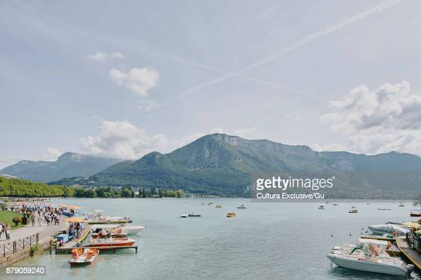 view of waterfront at lake annecy, annecy, auvergne-rhone-alpes, france - lake annecy stock photos and pictures