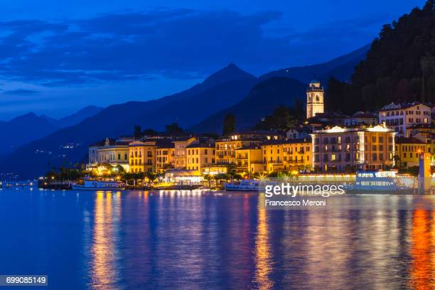 View of waterfront city lights at night, Lake Como, Italy