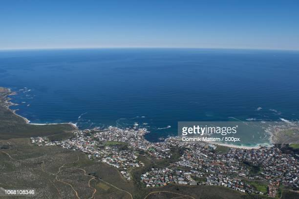 view of waterfront, sea and blue sky - afrika afrika stock pictures, royalty-free photos & images