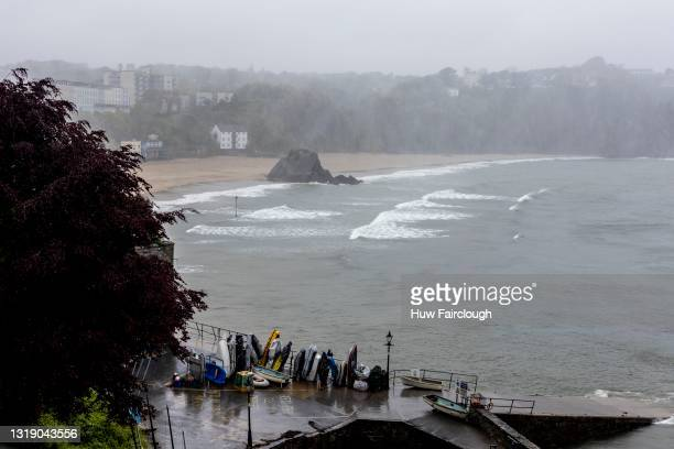 View of waves crashing on to St Catherine's Island and South Beach in high winds on May 20, 2021 in Tenby, Wales. The Met Office have issued a Yellow...
