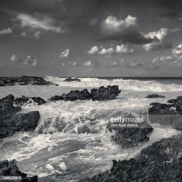 View of waves on a rocky shore, Isla Mujeres, Queretaro, Mexico, 2020.
