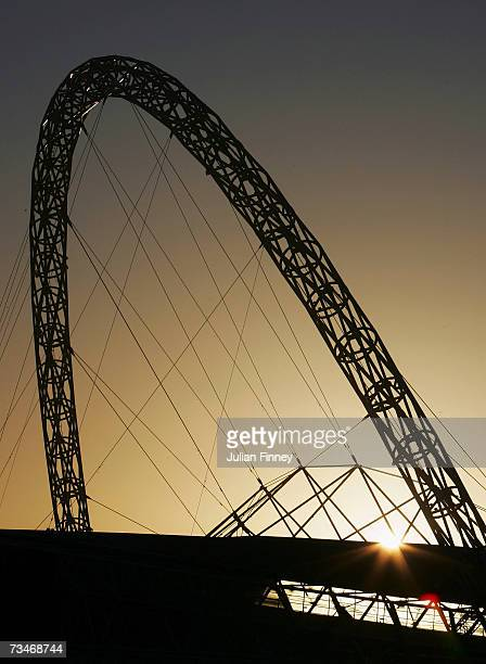 A view of Wembley Stadium's Arch is seen as the sun rises on March 2 2007 in London England