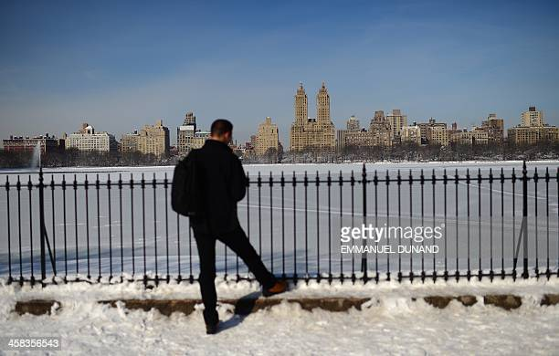 View of West Manhattan skyline behind a snow-covered Central Park Reservoir following a snow storm in New York, February 4, 2014. Up to nine more...