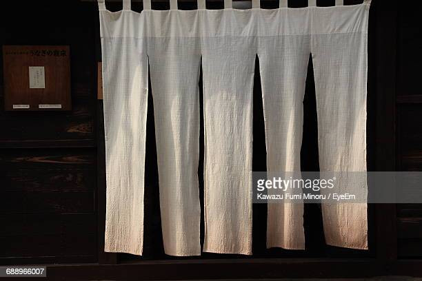 view of white curtains on door - のれん ストックフォトと画像
