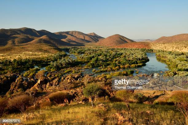 View of wide landscape with Kunene River and Epupa Falls, Kaokoveld, Namibia