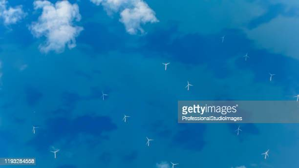 view of wind turbines generating electricity in english channel from aircraft - seascape stock pictures, royalty-free photos & images