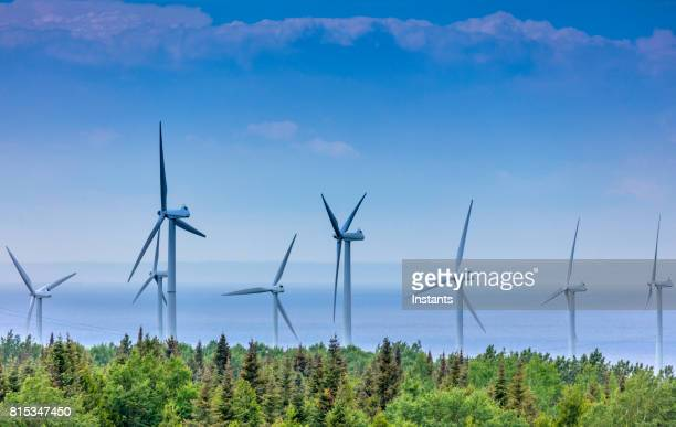 view of wind turbines near saint-lawrence river in la gaspésie region, situated in the canadian province of quebec. - gaspe peninsula stock pictures, royalty-free photos & images