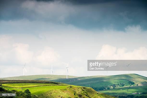 View of wind turbines on moorland hills, UK