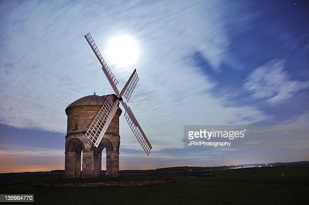view of windmill at night - chesterton stock photos and pictures