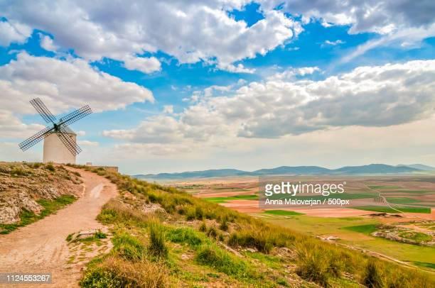view of windmill in consuegra, spain - castilla la mancha fotografías e imágenes de stock