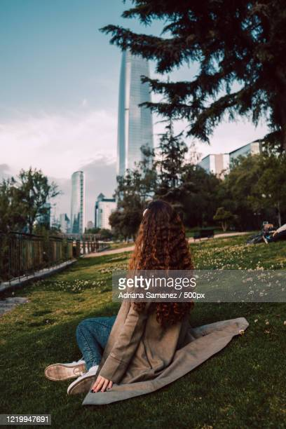 view of woman looking at skyscraper, santiagodechile, chile - santiago chile stock pictures, royalty-free photos & images