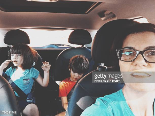 view of woman sitting in car - family inside car stock photos and pictures