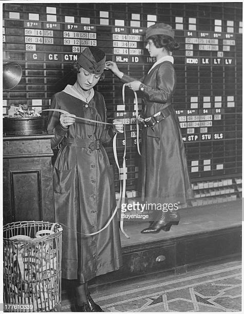 View of women operating stock boards at the Waldorf-Astoria, New York, 1918. Women were hired by the the Waldorf-Astoria Hotel to help release men...