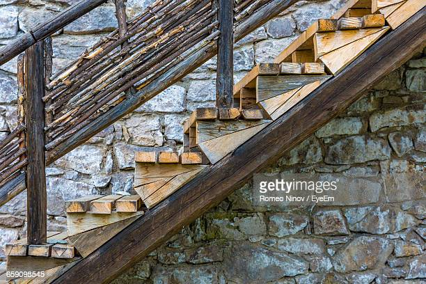View Of Wooden Steps Next To Stone Wall